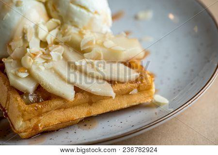 Wonderful Breakfast Or Dessert - Vanilla Ice Cream With Caramel Sauce On Belgian Waffle With Slices