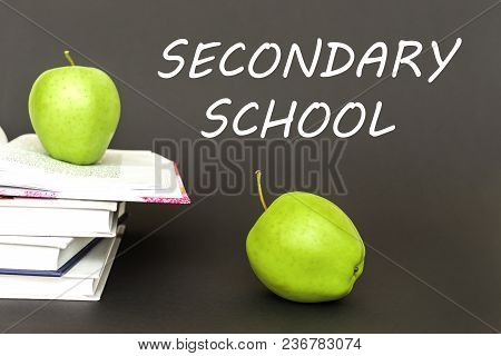Concept Back To School, Text Secondary School, Two Green Apples, Open Books On Gray Background