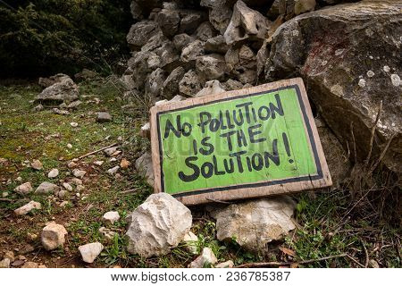 Green Handwritten Sign Lying On The Ground Saying No Pollution Is The Solution