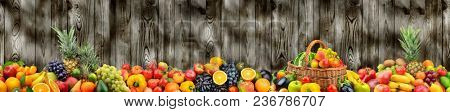 Panoramic photo healthy vegetables and fruits on background dark wooden wall. Free space for text.