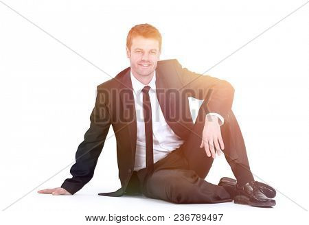 young businessman sitting on floor.
