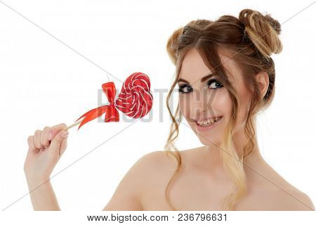 Portrait of cheerful young woman with lollipop on a white background. Pin up style.