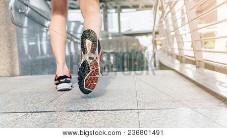 Athlete Runner Feet Running In The City Closeup On Shoe. Sportsman Fitness Jog Workout Wellness Conc