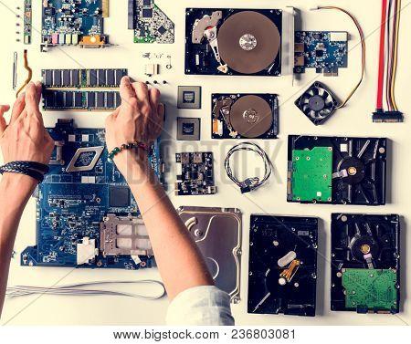 Hands holding a computer component part