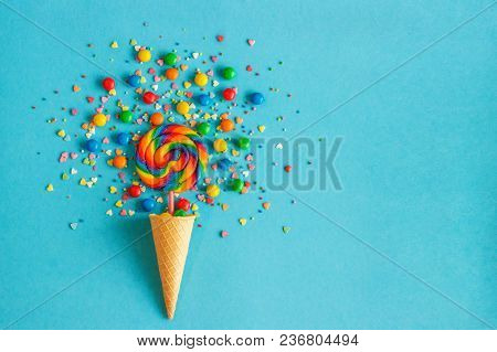 Ice Cream Waffle Cone With Colorful Lollipop On Stick, Scattering Of Multicolored Sweets And Confect