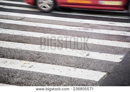 A White Zebra Crossing On A Road