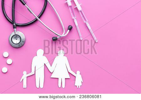 Vaccination As Way To Save Healthy Family. Syringe With Colored Vaccine Near Silhouette Of Family On