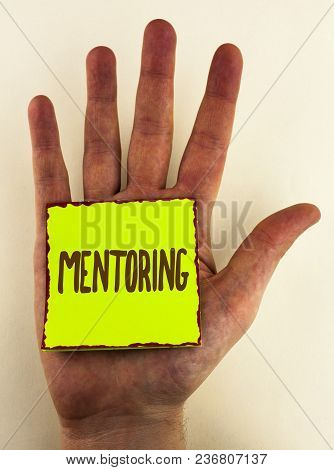 Handwriting Text Writing Mentoring. Concept Meaning To Give Advice Or Support To A Younger Less Expe