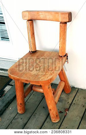 Vintage Wood Chair On Outdoor Wooden Terrace. Old Wooden Chair On Patio Floor. Vintage Wooden Chair
