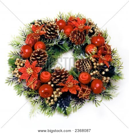 Christmas wreath with green leaves pine cones apples flowers and red balls on a white background. poster