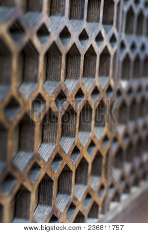 The Texture Of A Modern Wall With Multi-faceted Holes. Selective Focus.