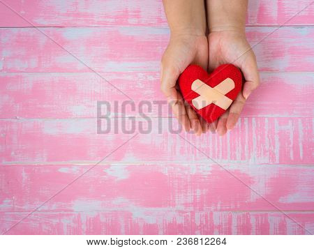 Health, Medicine And Charity Concept.  Heart On Aging Kid Hand Support
