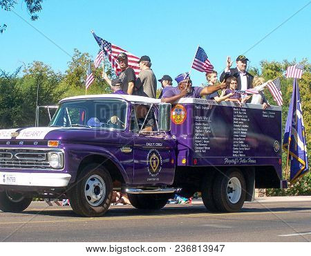 Phoenix, Az- Nov. 11:  Members Of The Military Who Had Received The Purple Heart Riding With Family