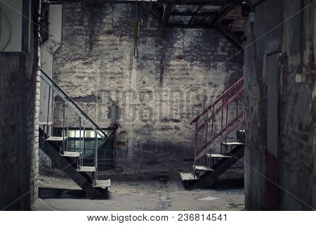 Dark Empty Yard With Two Staircases And A Hanging Loop. A Place For Suicide. The Theme Of Suicide. G
