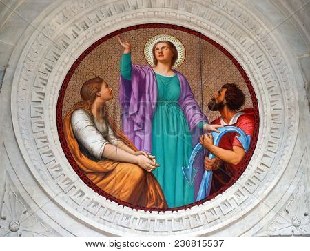 PARIS, FRANCE - JANUARY 10: Medallion of the portal represents the Hope, Saint Augustine church in Paris, France on January 10, 2018.