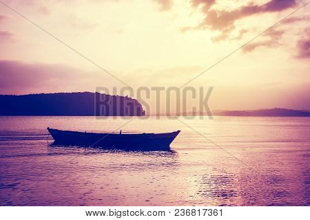 Beautiful Sunset Scene With A Small Boat. Retro-style. Andaman And Nicobar Islands India. Village Fi