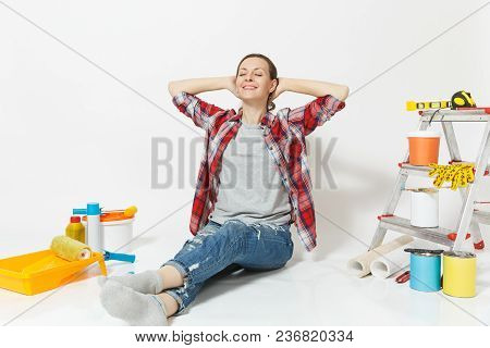 Woman Relaxes Holds Hands Behind The Head Sits On Floor With Instruments For Renovation Apartment Is