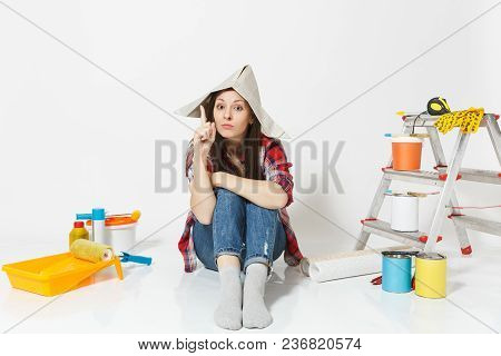 Beautiful Fun Woman In Newspaper Hat Sitting On Floor With Instruments For Renovation Apartment Room