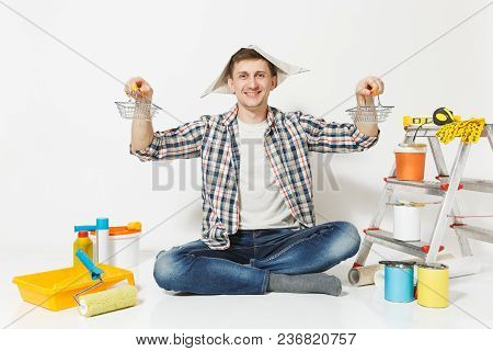 Happy Man In Newspaper Hat Holds Supermarket Metal Grocery Baskets For Shopping. Instruments For Ren