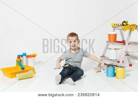 Little Cute Boy Sitting On Floor With Instruments For Renovation Apartment Room Isolated On White Ba