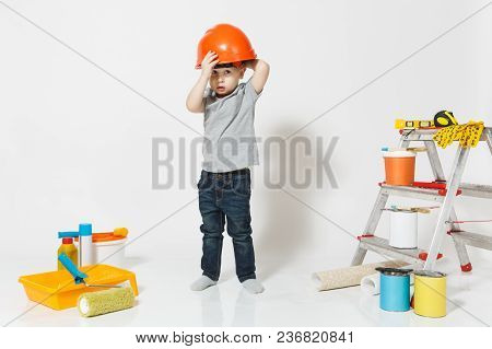 Little Boy In Orange Protective Helmet With Instruments For Renovation Apartment Isolated On White B