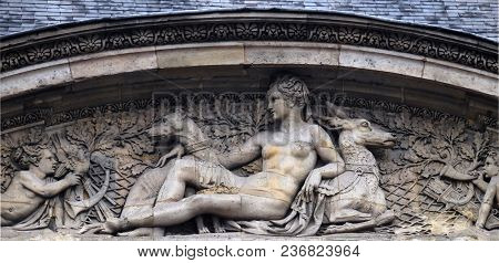 PARIS, FRANCE - JANUARY 11: Architectural fragments of Louvre building. Louvre Museum is one of the largest and most visited museums worldwide and one of major landmark in Paris, on January 11, 2018.