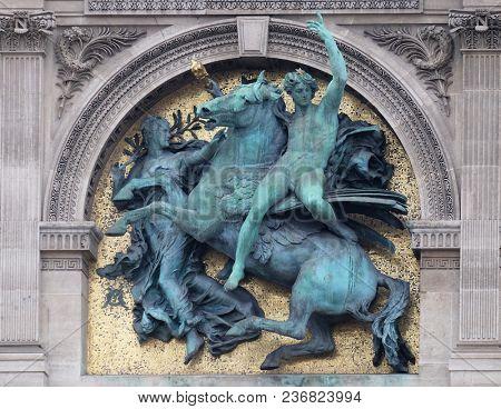 PARIS, FRANCE - JANUARY 11: Genius of the Arts Astride Pegasus by Marius Jean Antonin Mercie, architectural detail of the Louvre Museum, one of major landmark in Paris, France on January 11, 2018.