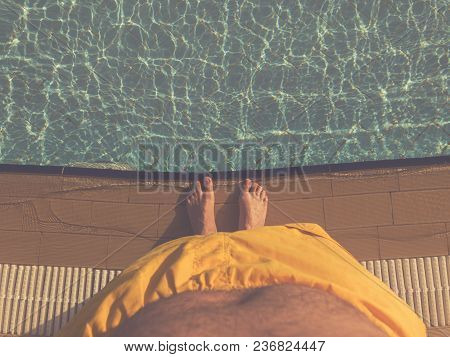 Man Enjoying At The Swimming Pool On A Hot Summer Day.