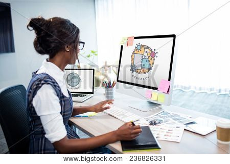 Girl using computers with education icons on the screen