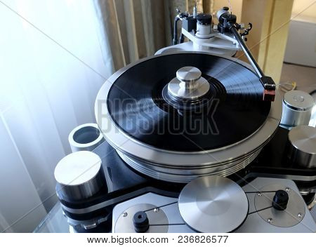 Modern High-precision High End Record Player With A Rotating Disc With An Installed Vinyl Record In