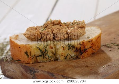 Sandwich With Norwegian Cheese-brunost On A White Wooden Table