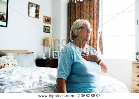 Senior woman having a heart problem