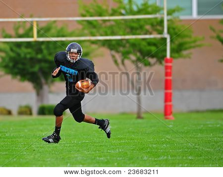 Youth American Football Running back going for it