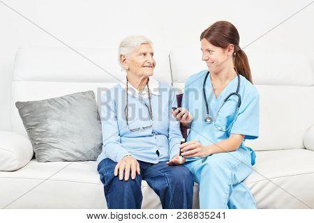 Nurse controls the blood sugar in a nursing home