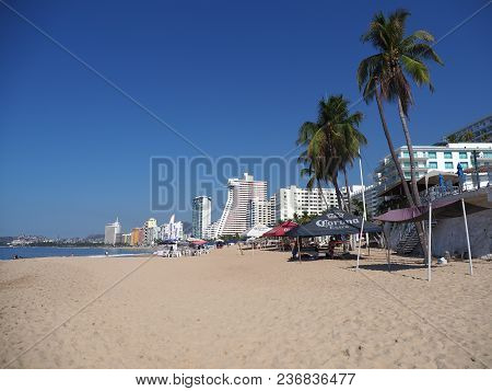 Acapulco, Mexico North America On March 2018: Hotel Buildings With Two Palm Trees On Beauty Sandy Be
