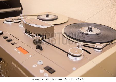 Part Of The Old Vintage Tape Recorder Is Brown With Tape Cassettes