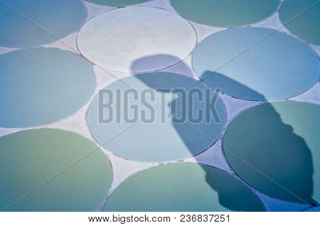 Shadow Of A Men On Striped Circle Concrete Background With Place Your Text/ Abstract Image