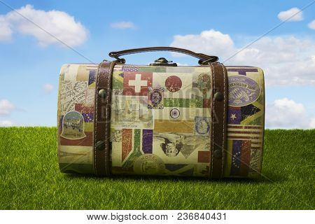 Nikolaev, Ukraine - April 16, 2018: Cute Tourist Retro Suitcase For Travelling On Summer Nature Back