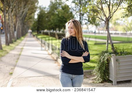 Young Female Person Walking In City, Enjoying Spring Warm Weather And Wearing Casual Clothes. Concep
