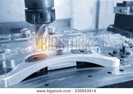 The Cnc Milling Machine Cutting The Aluminum Automotive Part With The Solid Ball Endmill In The Ligh