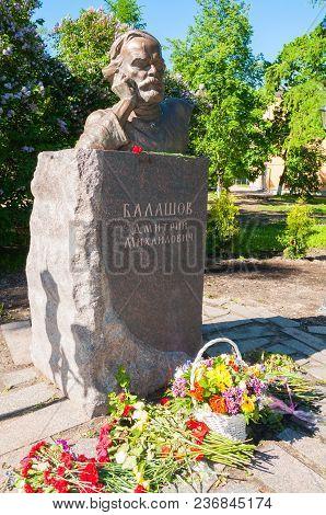 Veliky Novgorod, Russia - June 15, 2017. Monument To Russian Writer Dmitry Balashov With Flowers Nea