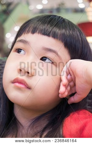 Portrait Of An Asian Little Girl With Blurred Background