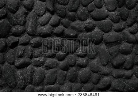 Black Stone Wall Texture. Painted Natural Large Pebble Surface. Dark Background