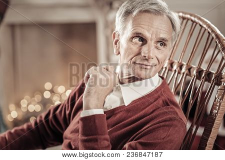 Watching You. Handsome Male Person Wrinkling Forehead And Raising Left Hand While Sitting On His Wic