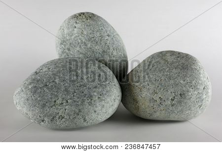 Three Pebbles Stone Isolated On White Background. Jadeite Stone.