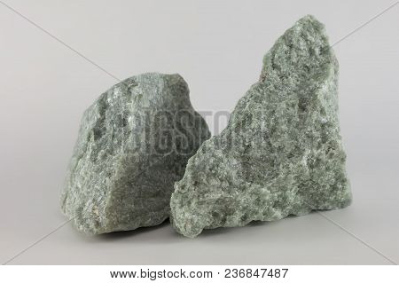 Close-up Of Two Raw Jade Mineral Stones, Isolated On White Background