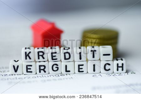 German Word Loan Comparison Formed By Alphabet Blocks: Kreditvergleich Real Estate Business