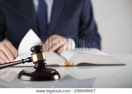 Man In Suit On White Background. Law Business Concept. Judge Gavel And Legal Code.