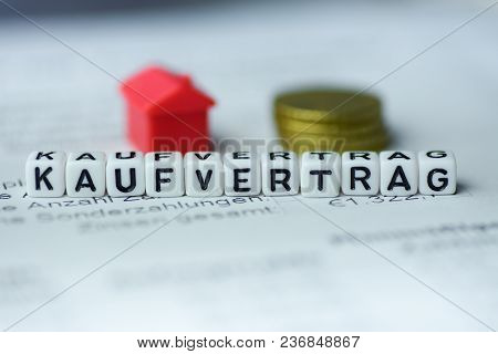 German Word Purchase Contract Formed By Alphabet Blocks: Kaufvertrag Real Estate Business