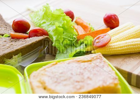 Healthy Lunch Concept. Sandwiches In Lunch Boxes, Lettuce, Cherry Tomatoes, Baby Corns And Carrots O
